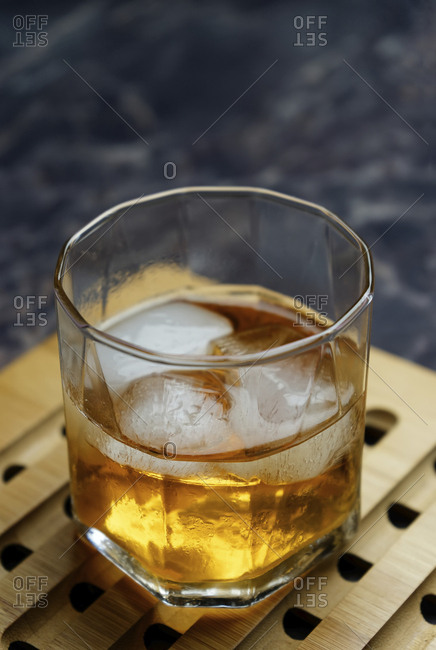 Close-up of ice cubes in alcoholic drink on tray