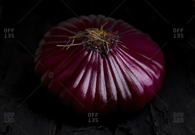 Close-up of onion on table against black background