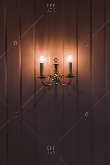 Illuminated lamps mounted on wall in room