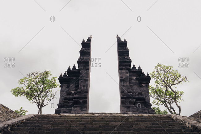 Old ruin of temple against sky at Bali