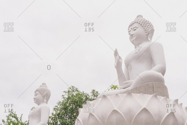 Low angle view of Buddha statues against clear sky