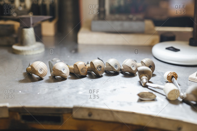 High angle view of wooden hand tools with numbers on table in workshop