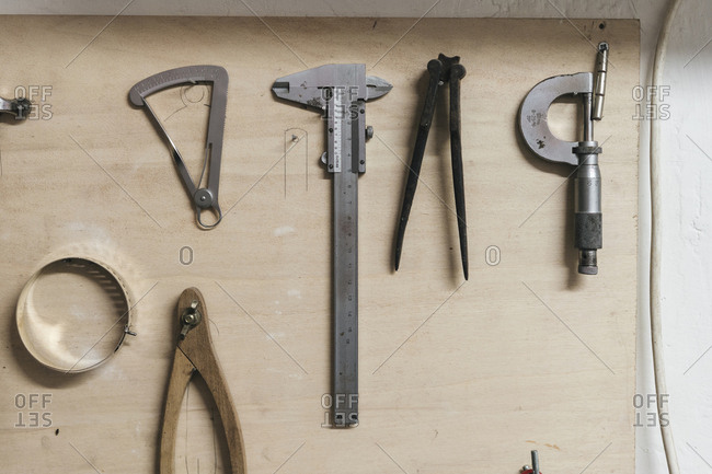 High angle view of hand tools on wooden table in workshop