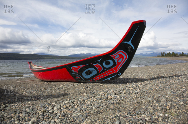 Teslin, Yukon, Canada - August 29, 2018: Red canoe on Teslin lake