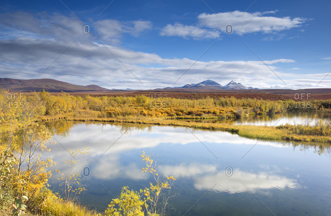 Fall colors surrounding lake off Dempster Highway in Yukon, Canada