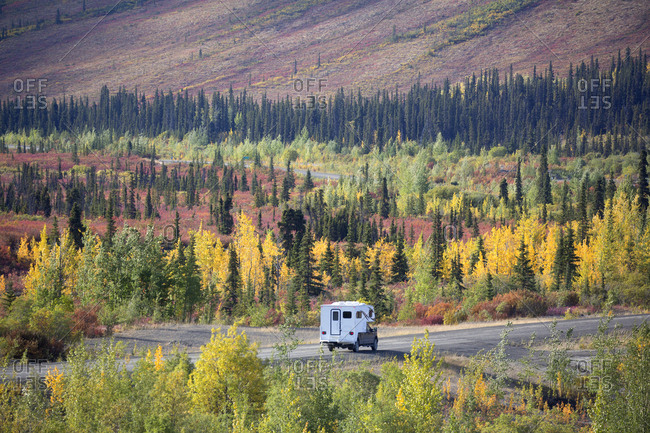 Camper truck on Dempster Highway in fall, Yukon, Canada