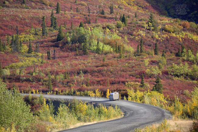 Camper truck on Dempster Highway in autumn, Yukon, Canada