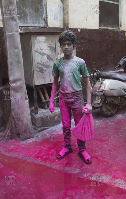 Mathura, India - March 5, 2015: Boy celebrating Holi time celebrations