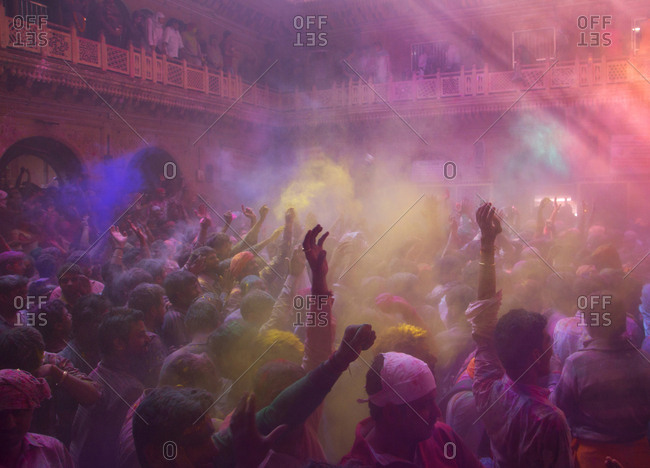 Mathura, India - March 5, 2015: Group of people at the Holi celebrations at the Bankey Bihari Temple