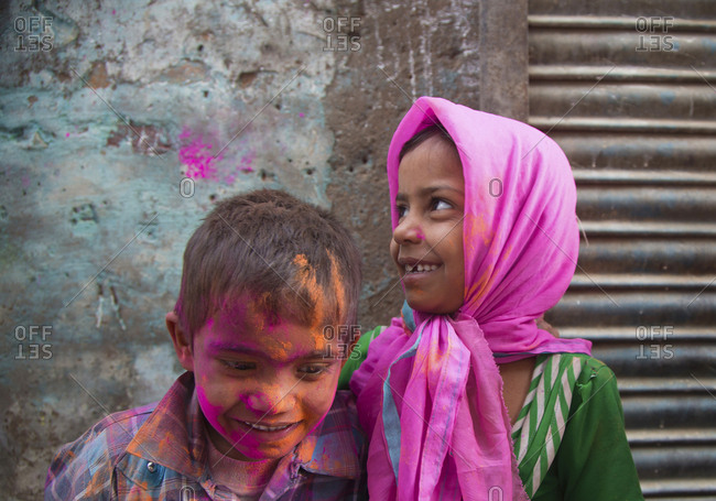 Mathura, India - March 5, 2015: Children playing at Holi time celebrations