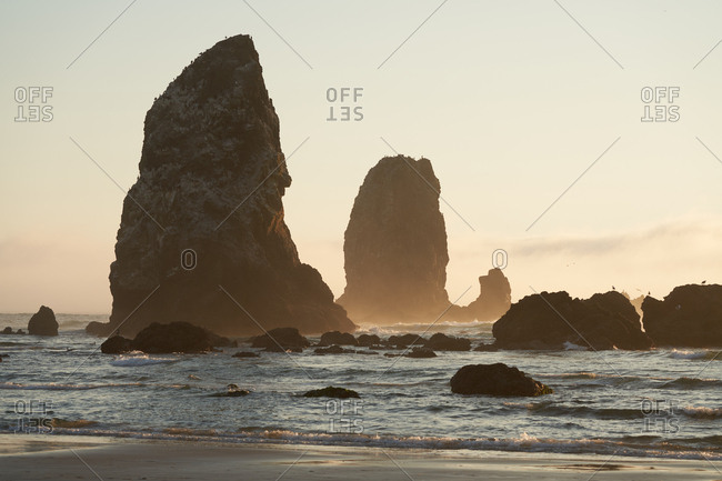 Sunrise over rock formations at Cannon Beach, Oregon, USA