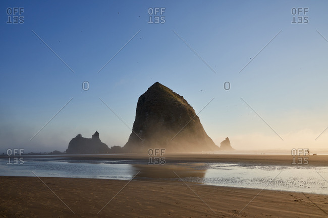 Haystack rock at sunrise on Cannon Beach, Oregon, USA