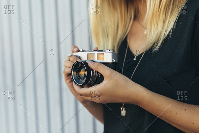 Close-up of woman holding a camera