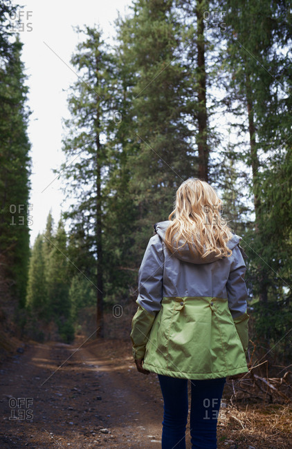 Blond woman exploring mountains and forest