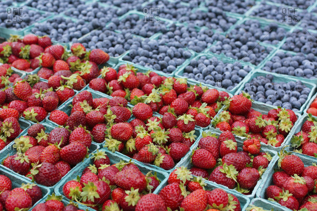 Farm fresh strawberries and blueberries at market