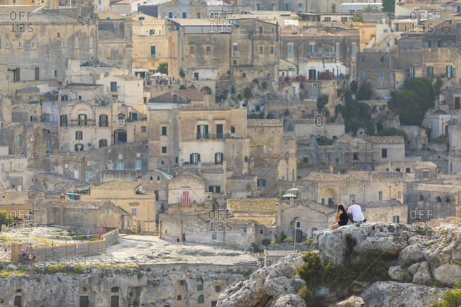 Young couple looking view of Matera, Basilicata, Italy
