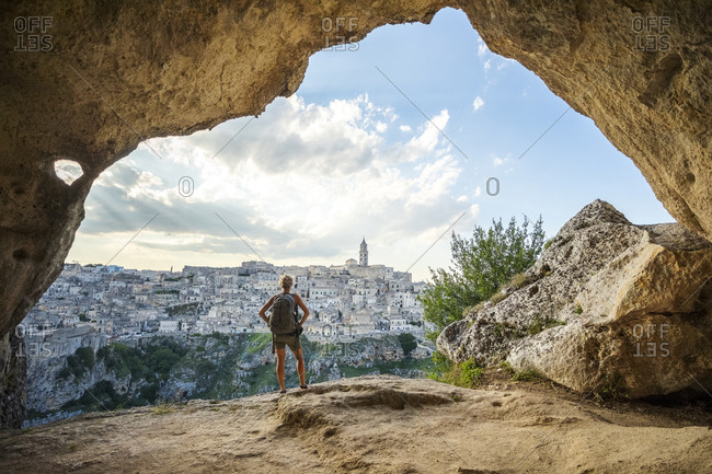 Woman looking at view from a cave of Matera, Basilicata, Italy