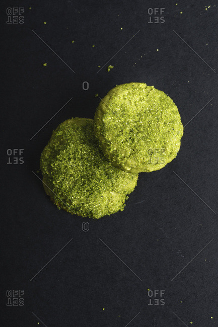 Overhead image of matcha cookies covered with sugar and matcha powder. matcha snickerdoodles
