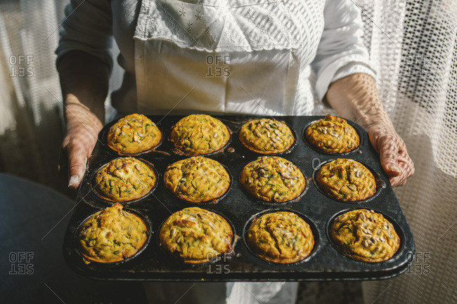 Cooks hands with corn muffin bread