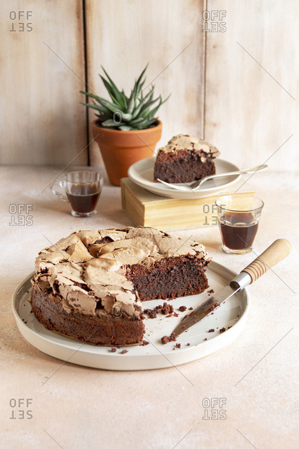Brownie meringue cake and two cups of coffee on the table