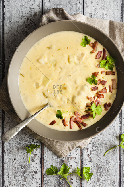 Bowl of potato and leek soup with a spoon.