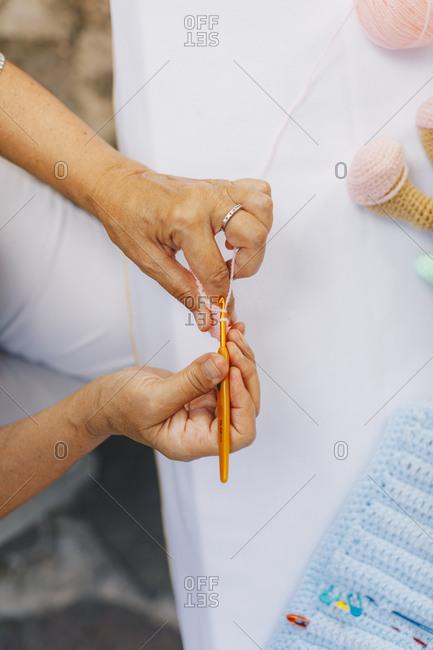 Overhead view of senior woman crocheting