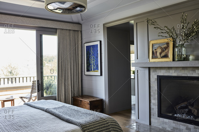 Santa Monica, California - August 8, 2018: Upscale bedroom interior with fireplace