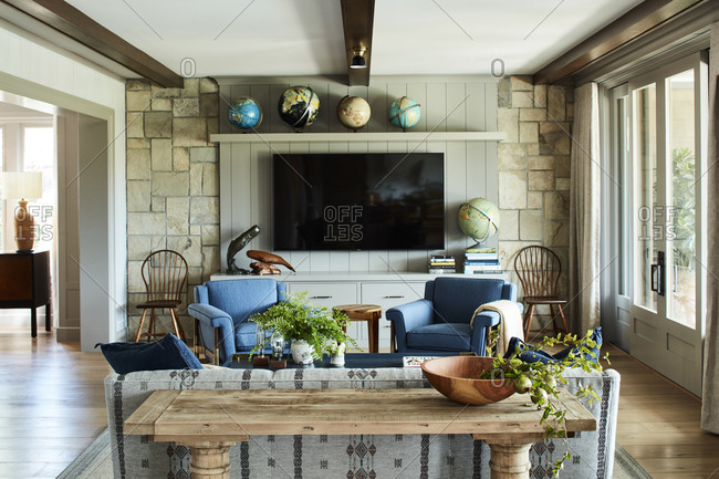 Santa Monica, California - August 9, 2018: Interior of a living room with a stone wall
