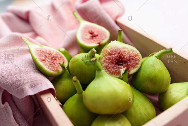 Fresh green figs in wooden box