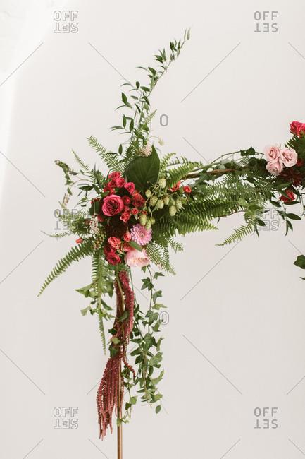 Detail of floral arrangement on wedding arch