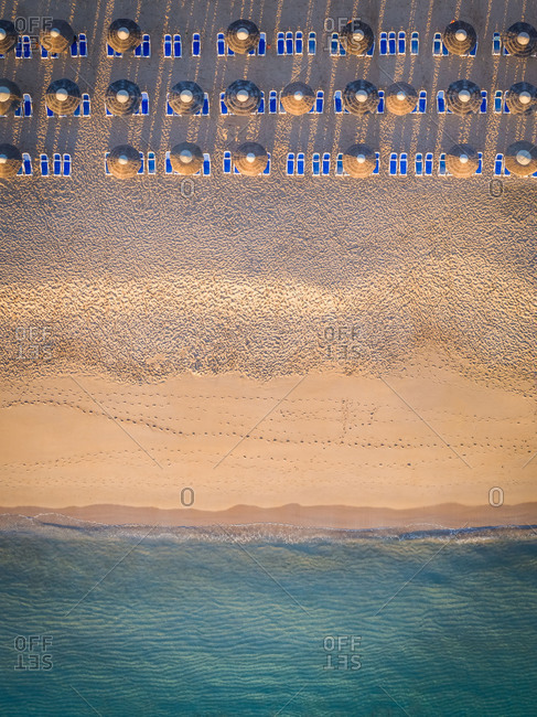 Aerial view of coastline beach , deck chairs and umbrellas in Al Aqah, Dubai.
