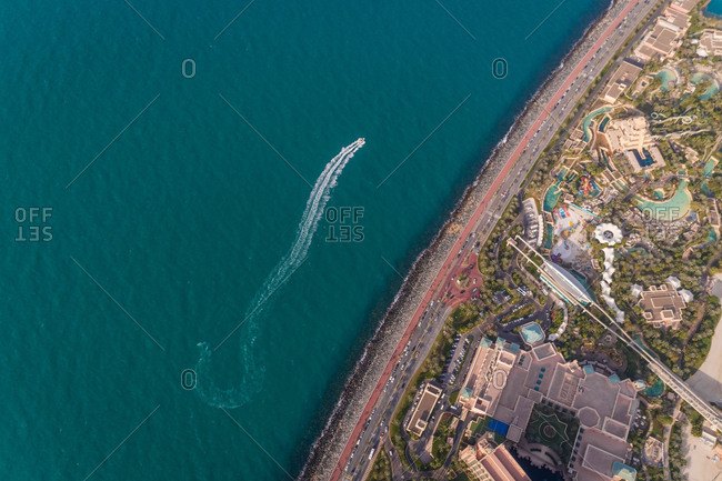 DUBAI, UAE5 JANUARY 2018: Aerial view of Atlantis, The Palm Hotel and speed boat in Dubai, UAE.