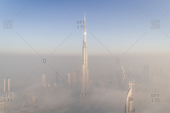 February 8, 2018: Aerial view of misty Burj Khalifa in Business Bay, Dubai, UAE.