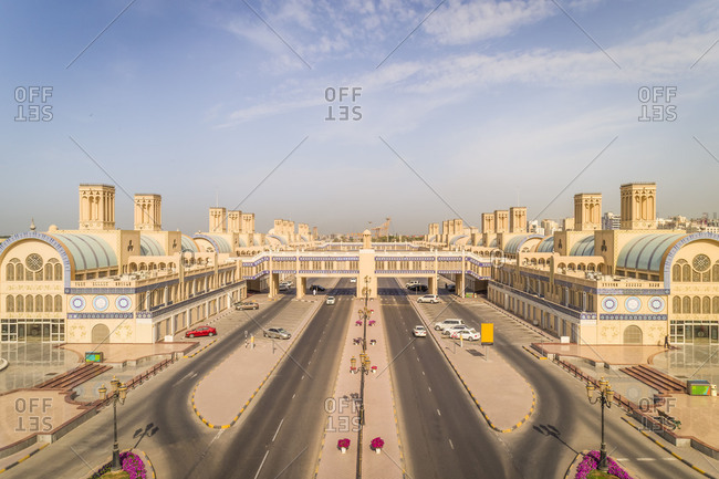 Aerial view of wide road and traditional arabic architecture near Al Qasima, UAE.