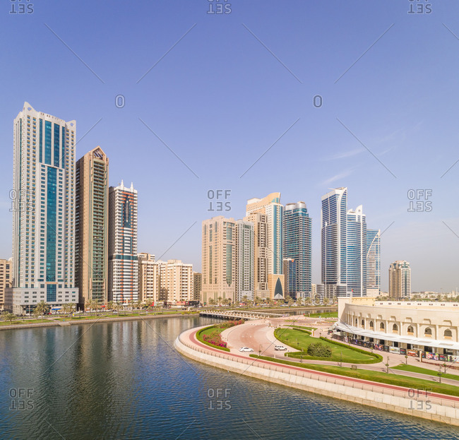 Aerial view of skyscrapers and Al Majaz island in Sharjah, UAE.