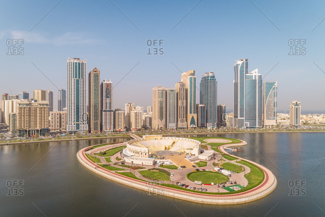 Aerial view of skyscrapers and  amphitheater in Al Majaz island in Sharjah, UAE.