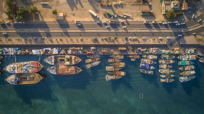 March 5, 2018: Aerial view of wooden boats moored in harbor near Flag Island, Dubai, UAE.