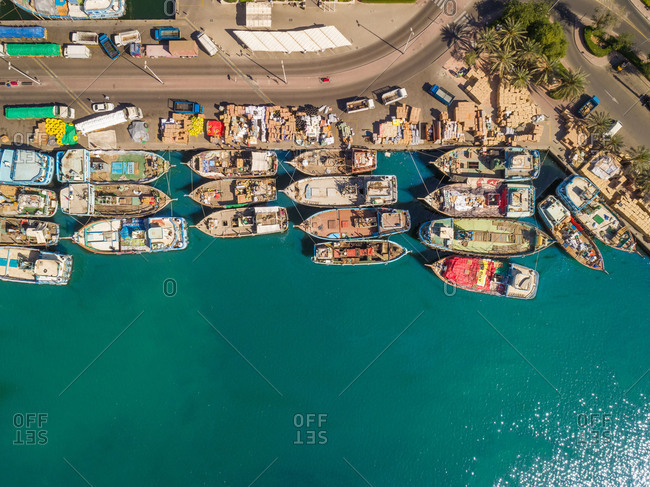 March 19, 2018: Aerial view of wooden boats in Dubai Dhow Wharfage harbor, UAE.