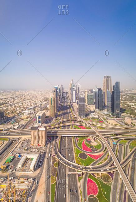 Aerial panoramic view of skyscrapers and roads by Burj Khalifa, Dubai, UAE.