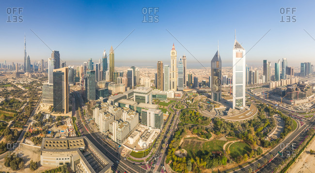 Aerial panoramic view of Dubai cityscape, Emirate Towers and skyscrapers, UAE.