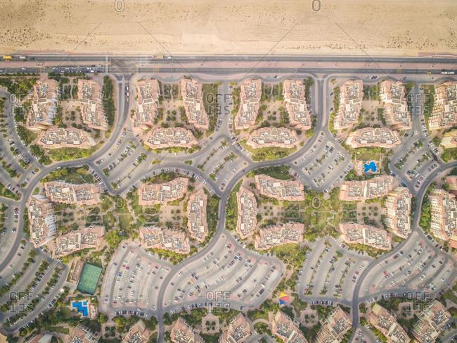 Aerial view of abstract, geometrical Discovery Gardens urban area, Dubai, UAE.