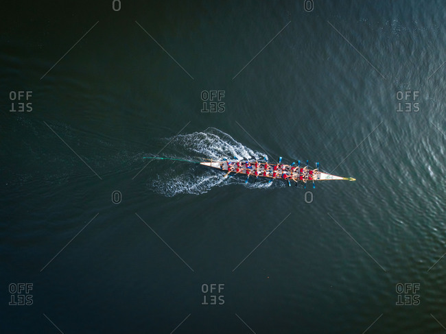 Aerial view of a single rowing boat and oarsmen in Dubai Creek, UAE.