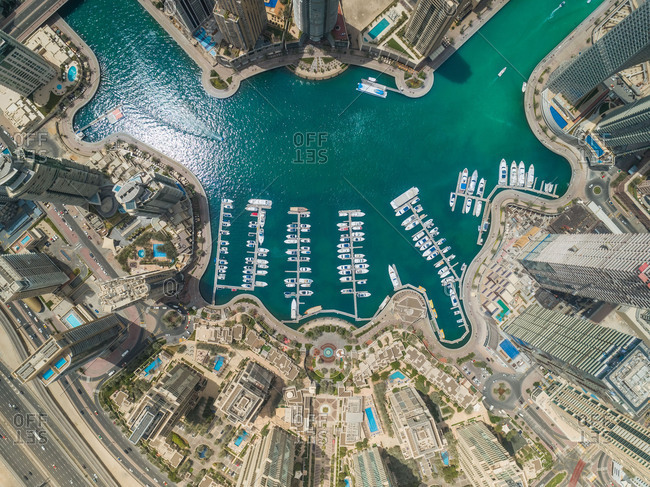 April 7, 2018: Aerial view of Dubai Marina with moored boats and skyscrapers, UAE.