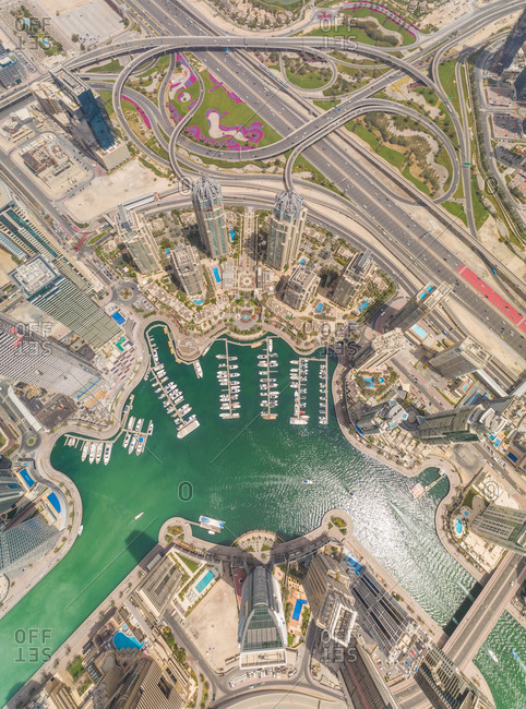 April 7, 2018: Aerial view of Dubai Marina, cityscape with skyscrapers and winding roads, UAE.