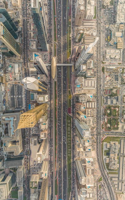 Aerial view of Dubai colorful skyscrapers, and long busy road ,UAE.