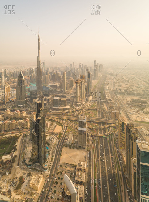 April 11, 2018: Aerial panoramic view of Dubai skyscrapers, roads and Burj Khalifa Tower, UAE.