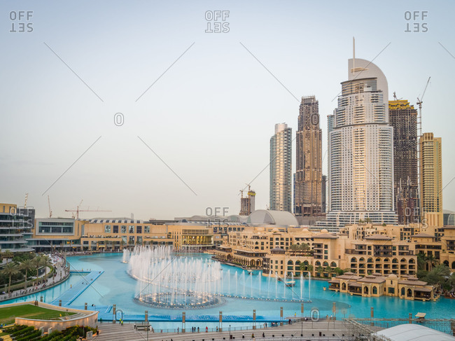 April 16, 2018: Aerial view of skyscrapers and turquoise fountain in Business Bay, Dubai, UAE.