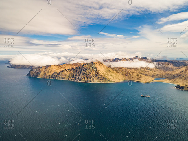 Aerial view of bay and industrial fishing vessel in Alaska, Dutch Harbor, USA.