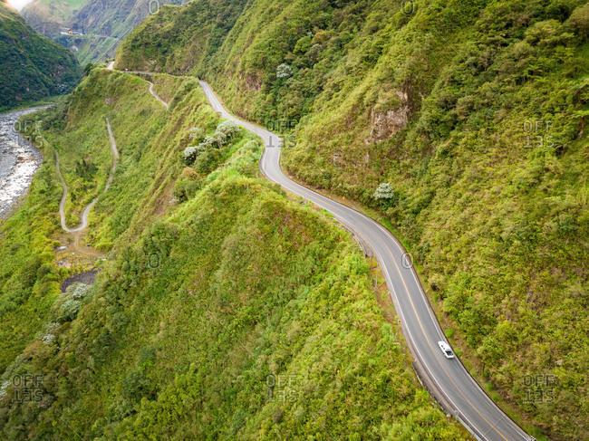 Aerial view of winding hillside road in Canton Banos, Tungurahua, Ecuador.