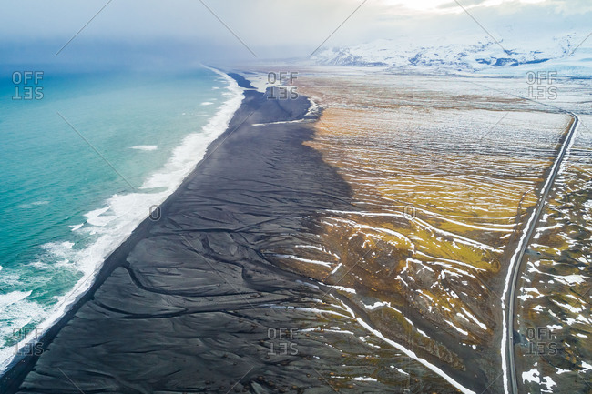 Aerial view of Diamond Beach and mountains, Iceland.